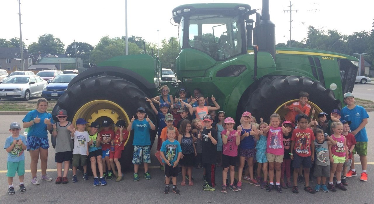 Summer campers with tractor